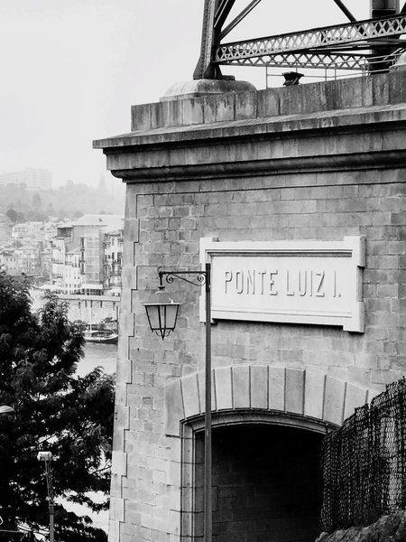 Text Architecture Western Script Built Structure Communication Building Exterior Day Outdoors No People Low Angle View City Sky Porto Portugal EyeEmNewHere Architecture History The Week On EyeEm Black And White Friday Shades Of Winter Summer Road Tripping
