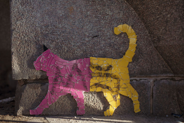 Yellow Pink Color Day Wall - Building Feature No People Architecture Outdoors City Close-up Pattern Textured  Built Structure Art And Craft Building Exterior Creativity Wall Nature Representation Graffiti Damaged Purple Cat Cats Of EyeEm Cats