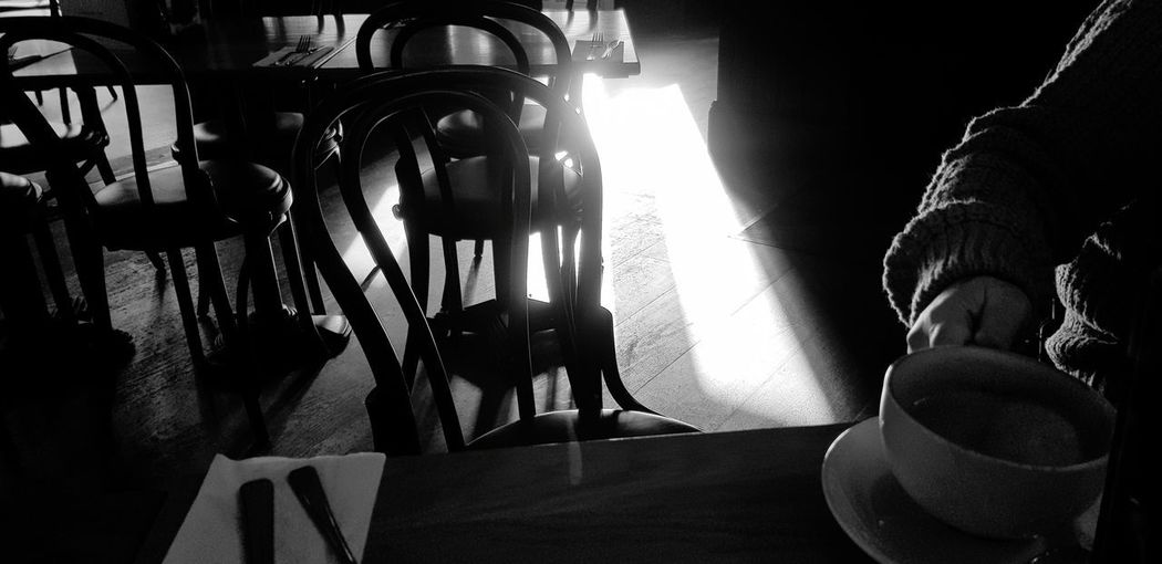 light Brunch Coffee Chairs Tables Blackandwhite Photography Black And White Hand Shaft Of Light Sunshine Shaft Of Light Latte Off Centre Human Hand Low Section Close-up Body Part Finger