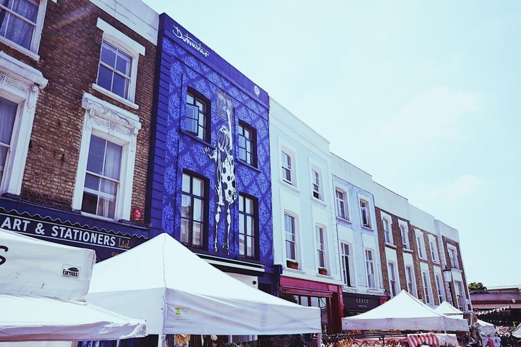 Notting Hill market buildings. Architecture Art Blue Building Building And Sky Building Art Building Exterior Built Structure City Clear Sky Communication Day London Low Angle View Marketplace No People Notting Hill Outdoors Sky Text