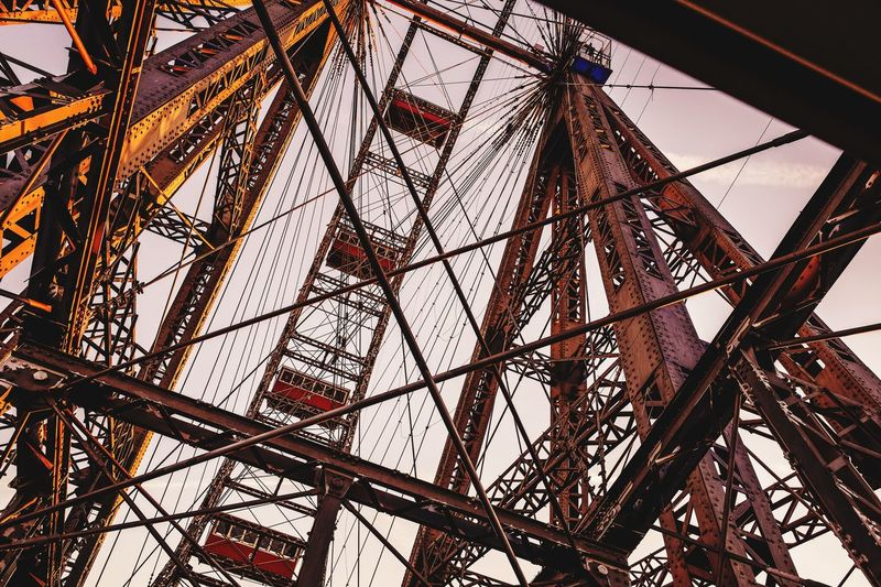 Wiener Riesenrad im Prater Ferris Wheel Fairground Warm Colors Low Angle View Pattern No People Built Structure Architecture Metal Day Outdoors Sunlight