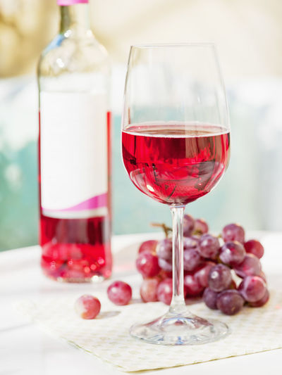 Close-up of red wine in glass on table