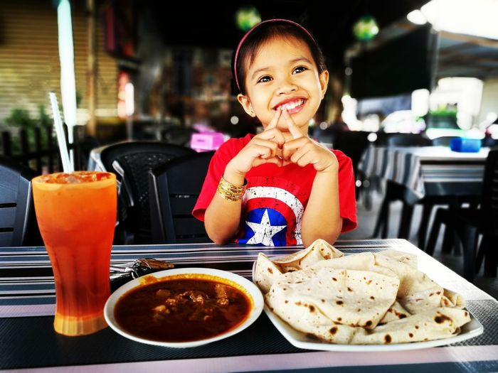 having breakfast with daughter Portrait Child Smiling Eating Drink Happiness Fast Food Cheerful Looking At Camera Girls Indian Food First Eyeem Photo