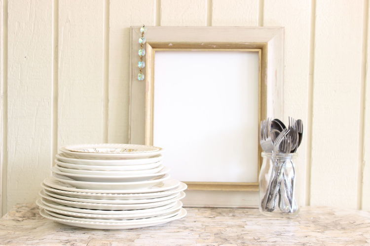 Plates And Cutlery With Picture Frame On Table