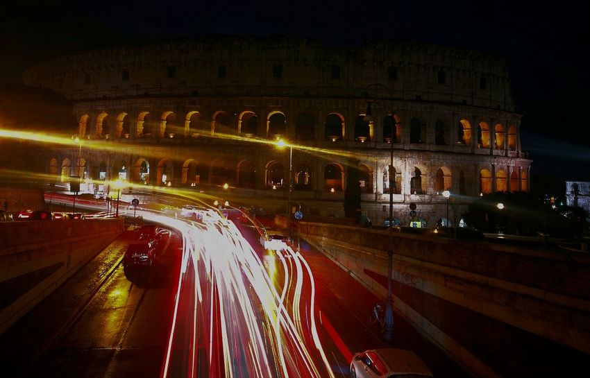 #Rome Romebynight Colosseum Caputmundi ItsColdOutside Nightwalk Traffic Lights Homeiswheretheheartis Illuminated Light Trail Night Speed Traffic Long Exposure Motion