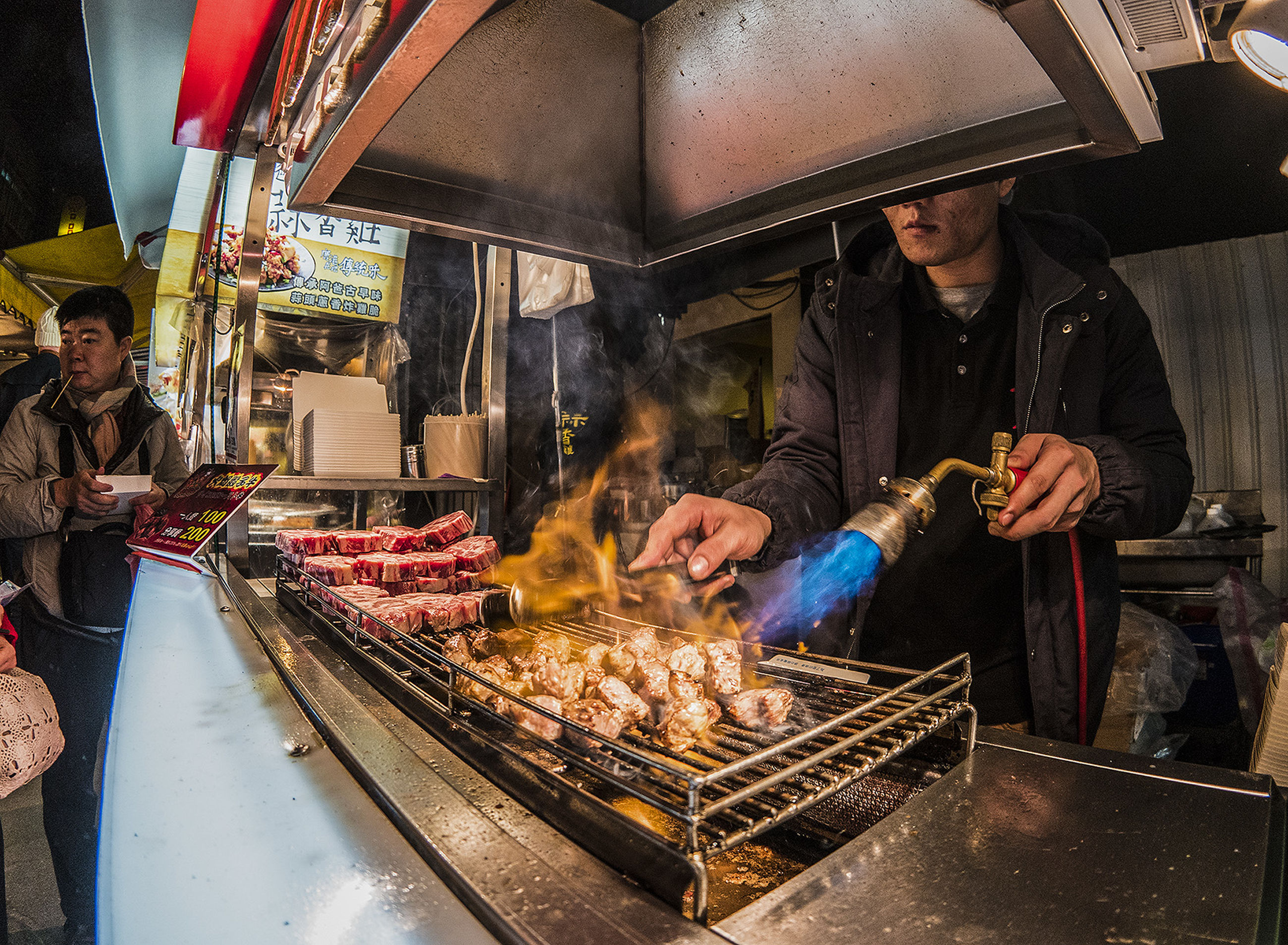 food and drink, food, lifestyles, freshness, preparation, holding, working, indoors, casual clothing, occupation, leisure activity, cooking, preparing food, meat, retail, barbecue grill, men, barbecue