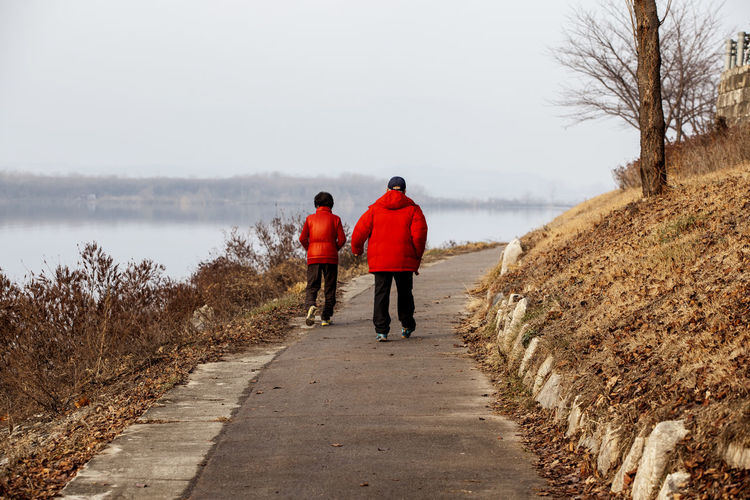 Composition Day Escapism Full Length Getting Away From It All Gongjicheon Grass Lakeside Landscape Leisure Activity Lifestyles Man And Woman Men Narrow Outdoors Perspective Real People Rear View Standing The Way Forward Trail Tranquil Scene Walkway Weekend Activities Women