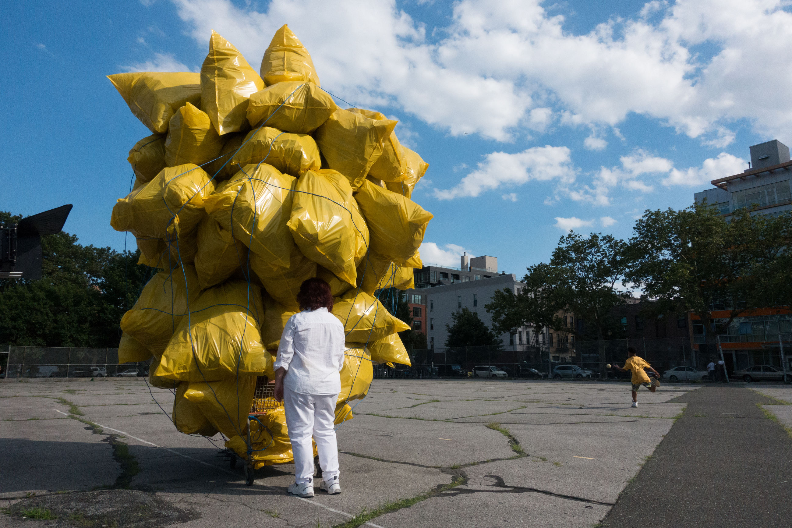 statue, sculpture, human representation, real people, architecture, built structure, building exterior, outdoors, sky, cloud - sky, yellow, day, men, tree, people