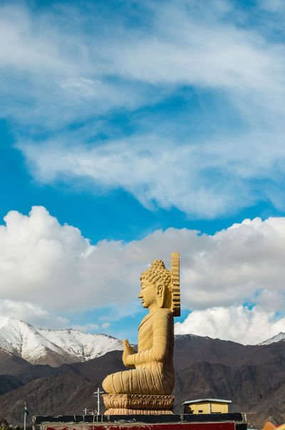 Buddha God Gold Himalayas India Ladakh Love Art And Craft Blue Buddhism Cloud - Sky History Idol Low Angle View Place Of Worship Religion Sculpture Sky Spirituality Statue Travel Destinations Yellow
