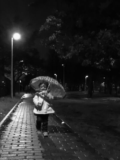 Black And White Friday Night Childhood One Person Real People Walking Outdoors Illuminated Child EyeEm Best Shots Child Outdoor Under Umbrella Umbrella Bw Streetphotography Bwphotography Walking Home Young Adult Toddler  Toddlerlife In The Park Rushing