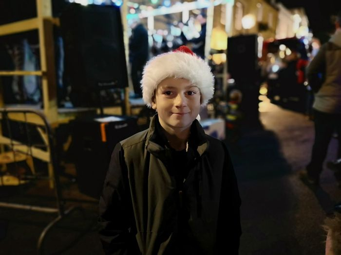 Christmas light switch on in helston Santa Hat Boy With Santa Hat On In The Street Holidays Christmas Portrait Warm Clothing Looking At Camera Business Finance And Industry Waist Up Posing Head And Shoulders Holiday Moments