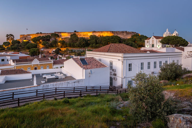 Castle of Castro Marim, Algarve, at sunset Architecture Building Exterior Built Structure Building Plant Residential District Nature Sky No People Tree House City Day Roof Clear Sky Blue Outdoors High Angle View Town Sunlight TOWNSCAPE Castro Marim Portugal Algarve Castle Vilage Village