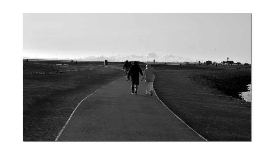 Sunset At San Leandro Marina 6 Couple Walking Shoreline Park Trail Bicyclist Paved Walkway Sundown Sunset Sunset Silhouettes Sunset_collection Sky And Clouds San Francisco Skyline Fog Marine Layers! AirPlane ✈ Airport Tower Banks Shoreline Monochrome Monochrome_Photography Landscape Landscape_Collection Healthy Living Enjoying Life Black & White Black & White Photography Black And White Black And White Collection  Trees Sunset_lovers Landscape_photography
