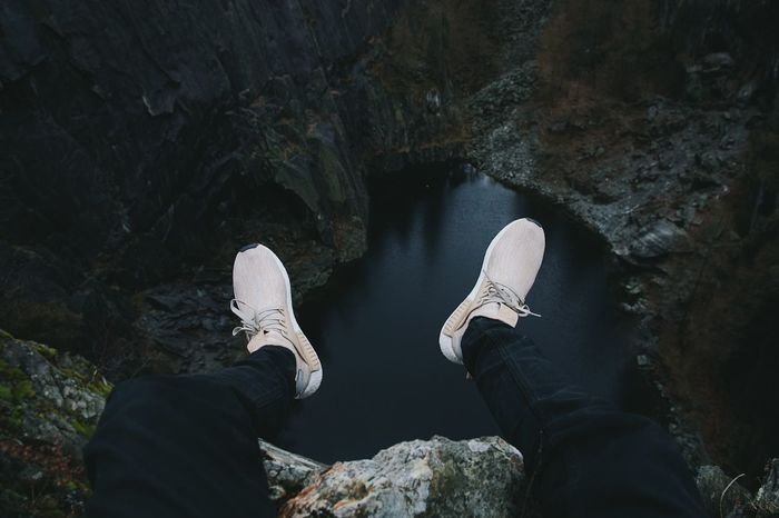 Sat on the edge of Hodge Close Quarry In The Lake District, Cumbria, England wearing Adidas NMD XR1 on a dull winters day Adidas Nmd Dangerous Edge Endland Feetselfie Height Hodge Close Quarry Leisure Activity Lifestyles Looking Down Nature On The Endge One Person Outdoors Personal Perspective Rock - Object Texture The Lake District  Up High VSCO Water