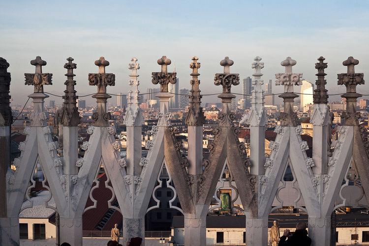 Crosses of duomo di milano against sky