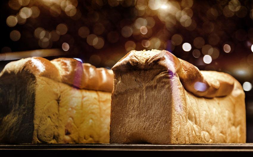 New bread on bakery shop on night light reflex on mirror