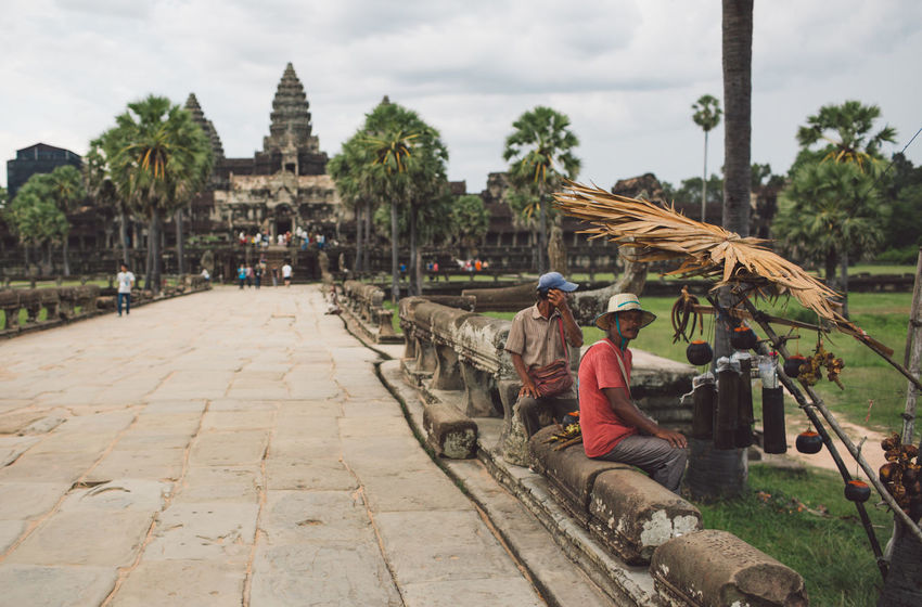 Siem Reap Cambodia Angkor Angkor Wat Angkor Wat, Cambodia Architecture Built Structure Real People Sitting Adult Tree One Person Religion Nature Plant Day Building Exterior Belief Men Spirituality Clothing Place Of Worship Sky Women Outdoors