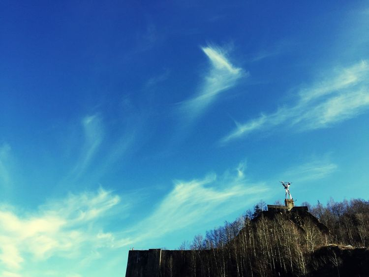 Sky Low Angle View Built Structure Cloud - Sky Architecture Outdoors Building Exterior Nature No People Television Aerial Technology Antenna - Aerial Telecommunications Equipment Renewable Energy Day Statue Ironwork  Ironstructure Ironstatue Travel Destinations Perspectives On Nature