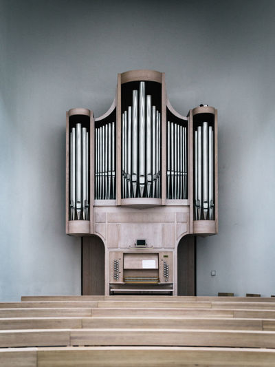Pew And Pipe Organ At Church