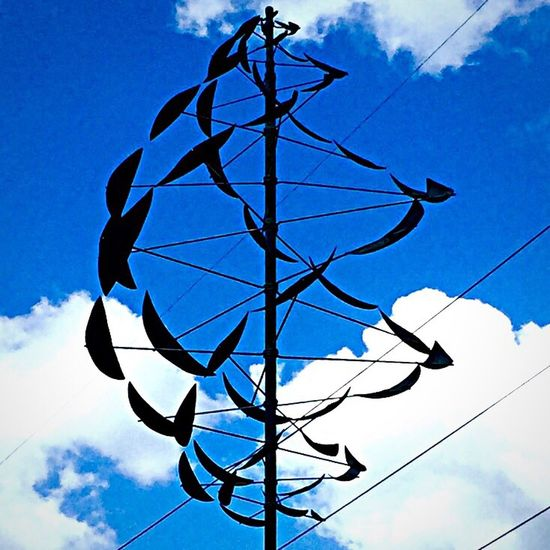 Metalartwork Local Market Windpowered Blue Sky White Clouds Black Metal Power Lines