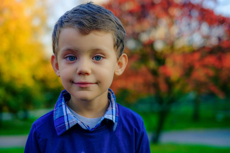 Portrait of boy smiling outdoors