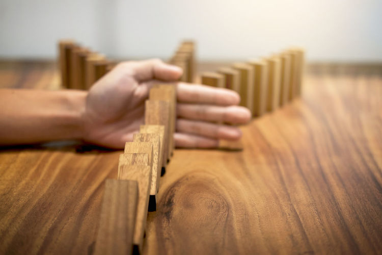 Cropped Hand Playing With Wooden Blocks On Table
