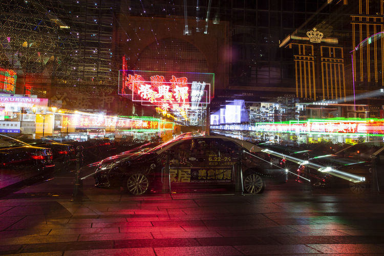 Digital composite image of illuminated street and buildings at night