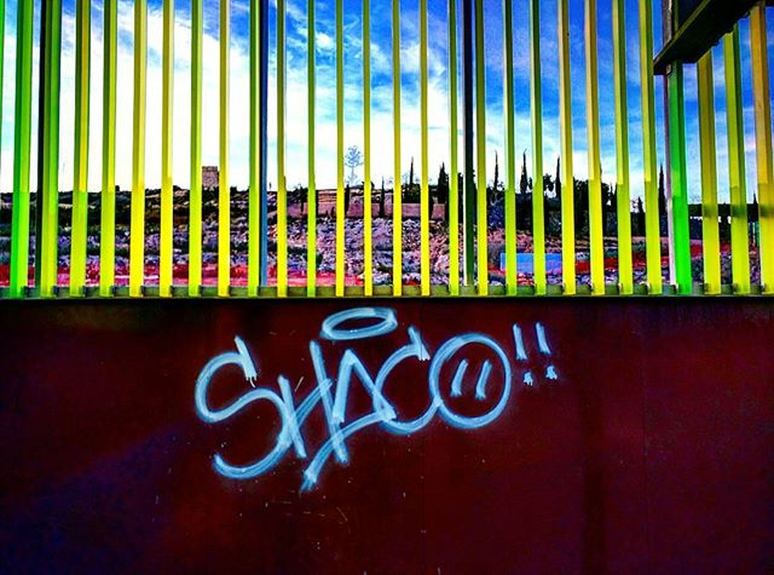 text, western script, graffiti, communication, wall - building feature, built structure, blue, architecture, capital letter, art, pattern, creativity, no people, wall, indoors, close-up, closed, street art, day, building exterior