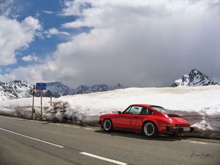 on the road to the Lago del Garda Bernina Pass Switzerland Red Car Porsche 911 Mountain Car Sky Transportation Snow Mountain Range Nature Cold Temperature Cloud - Sky Landscape Road Red Beauty In Nature Scenics