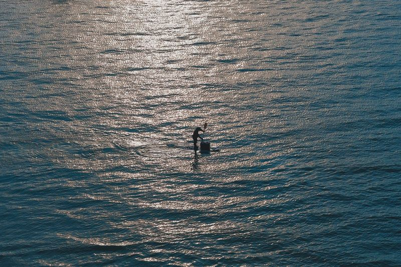 Adventure Beauty In Nature Day High Angle View Leisure Activity Lifestyles Men Motion Nature One Person Outdoors Real People Scenics - Nature Sea Silhouette Sport Unrecognizable Person Water Waterfront