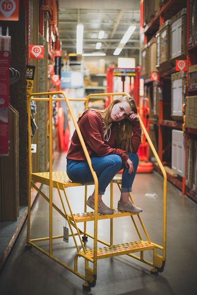 Portrait Sitting Beautiful Ladder Home Depot Indoors  Exercising Only Women Chair Lifestyles One Person Adults Only