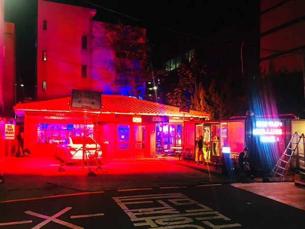 Night City Illuminated Built Structure Building Exterior Architecture Street Red Road Sign Transportation Lighting Equipment Neon City Life Incidental People Building Outdoors Multi Colored Nightlife City Street