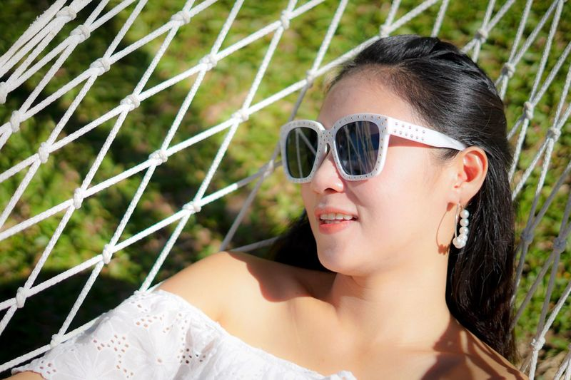 She is happy on holiday Beach Thailand Travel Holiday EyeEm Selects One Person Headshot Fashion Sunglasses Portrait Glasses Women Outdoors Lifestyles Females Adult Beautiful Woman Plant Day Leisure Activity Young Adult Real People Young Women Nature Hairstyle