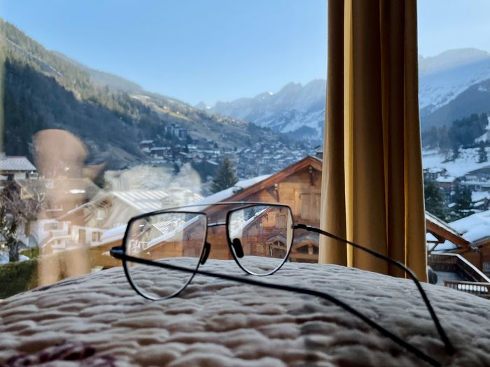 Snow covered landscape seen through window