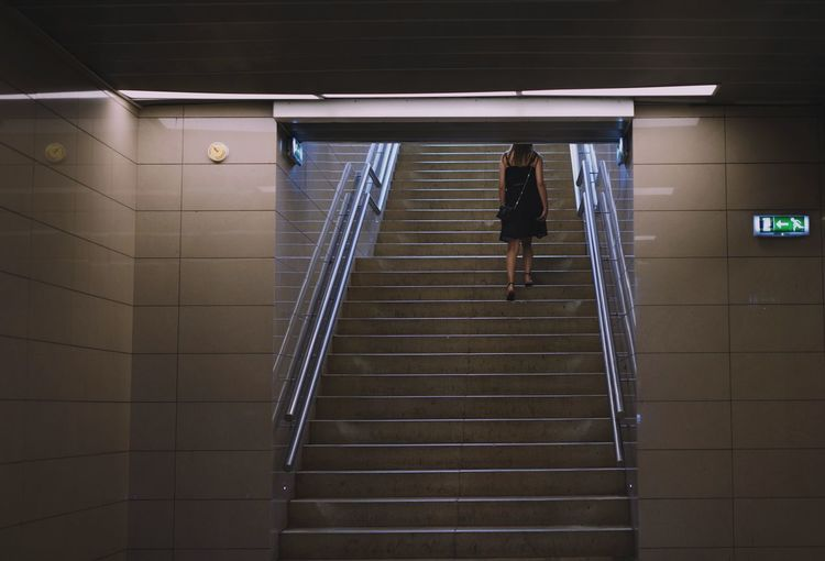 Architecture One Person One Woman Only Minimalism Minimal Full Length Steps And Staircases Climbing Steps Staircase Illuminated Hand Rail Stairs Underpass Subway Underground Walkway Subway Station Stairway Walking Ceiling Light