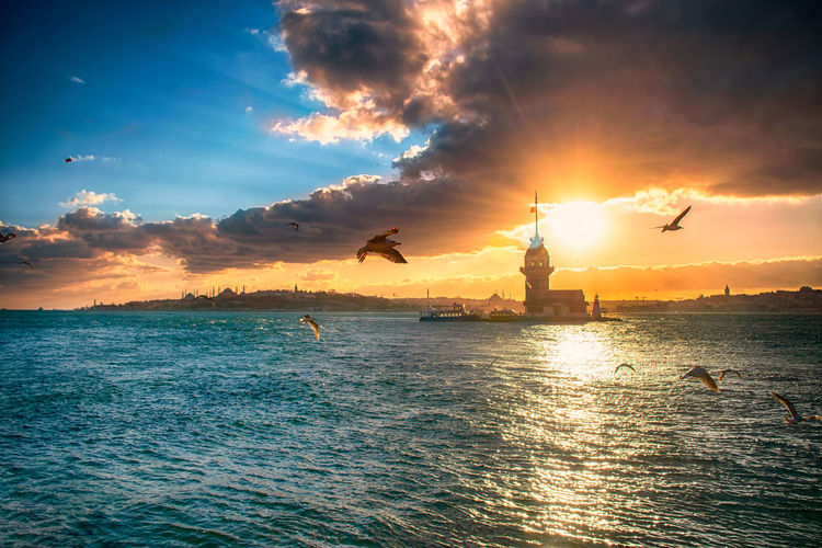 Scenic maiden's tower view of sea against sky during sunset
