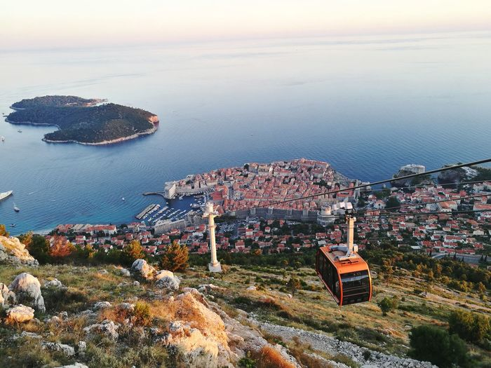 Mount Srđ overlooking the walled city of Dubrovnik Water Dubrovnik Croatia Coastline Coast Cable Car Srđ Mount Srđ Mountain View Dubrovnik, Croatia Travel Photography Old Town City Blue Sky Islandhopping Blue Walled City Sunset Sea Sunset Beach Cityscape Sky Architecture Horizon Over Water Building Exterior The Traveler - 2018 EyeEm Awards EyeEmNewHere