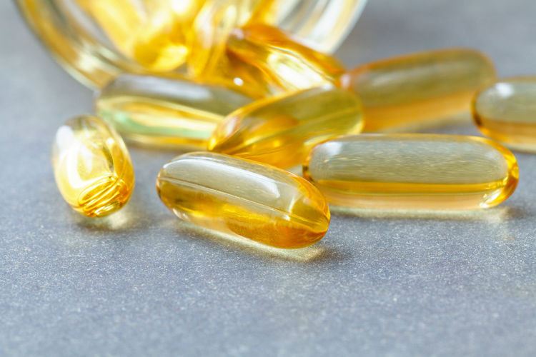 Close-up of yellow capsules on table