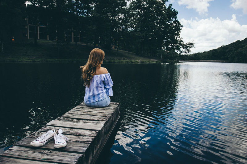 What are your plans for the summer?The Great Outdoors - 2017 EyeEm Awards The Portraitist - 2017 EyeEm Awards One Person Water People Lake Children Only Long Hair Reflection Rear View Adult Women One Girl Only Nature Outdoors Sitting Childhood Beauty Day Young Adult Blond Hair Sky Adults Only Portrait One Young Woman Only