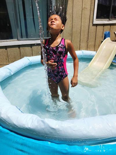 Full length of girl in wading pool