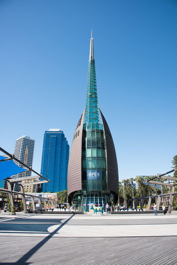 November 16,2016: Swan Bell Tower, tourists and public cow sculpture art installation in Perth, Western Australia. Architecture Australia Bell Tower Building Exterior Built Structure City Cityscape Cow Modern Outdoors People Perth Sculpture Sky Skyline Skyscraper Spire  Swan Bell Tower Tourism Tourist Tourist Attraction  Tower Travel Destination Travel Destinations Western Australia