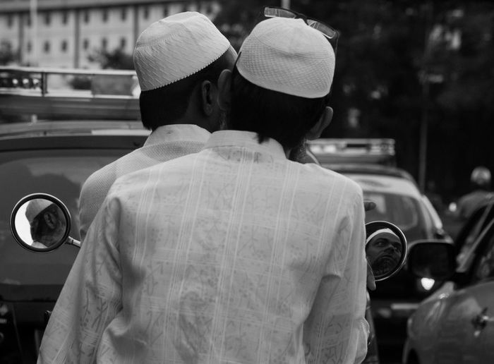 Rear View Of Two Islamic Men