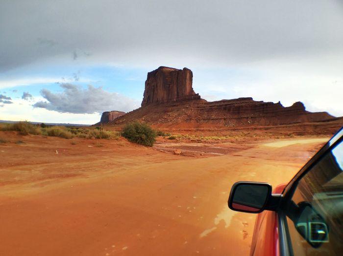 Car Driving Towards Rock Formation