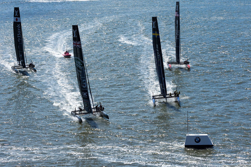 Closing in on the mark. Four of the six competing boats (from left to right: Japan, UK, Sweden, USA) are closing in on a mark close to Lower Manhattan in the second race on May 8, 2016, on the Hudson River in New York, NY. The Louis Vuitton America's Cup World Series races were held in May 2016 in New York City, after a break of 96 years. The boats are AC45F catamarans with hydrofoiling daggerboards, rigid wings, and five man crew. Adventure Aquatic Sport Beauty In Nature Day Extreme Sports Lifestyles Men Nature Nautical Vessel Outdoors People Real People Sea Sport Water America's Cup Mark Race Sailing Boat Sailracing