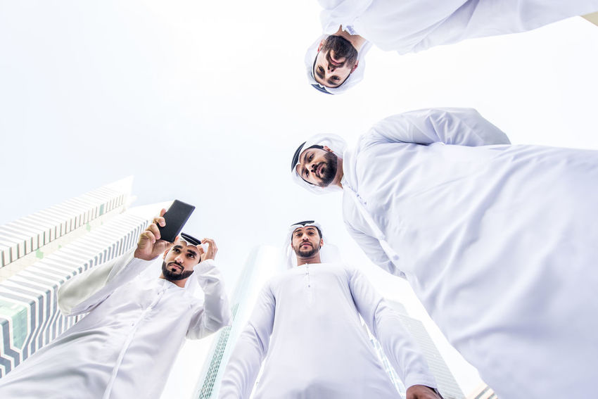Group of arabian businessmen with traditional dress Arabian Business Dress Meeting Meeting Friends Middle East Traditional Clothing UAE Arabic Businessmen Businesspeople Formal Friendship Gulf Islamic Kandora Kandura Men Middle-eastern Muslim Outdoors People Wear White First Eyeem Photo