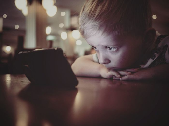 Downtime Chilling Watching Concentration Boys Technology Child Childhood Headshot Table Smart Phone The Portraitist - 2018 EyeEm Awards