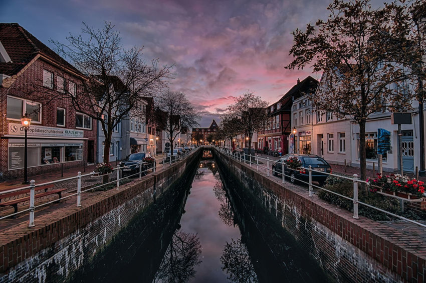 Travel Destinations Outdoors No People European Architecture Multi Colored Europe Architecture_collection Wide Angle View TOWNSCAPE Town City Cityscape Illuminated Night Photography Pink Sky Autumn Colors Buxtehude Germany City Life Reflection Canal Waterfront Water Reflections Silhouette Autumn