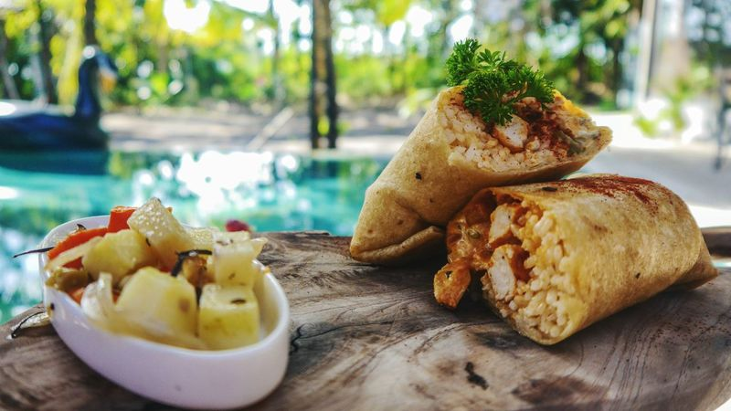 Mealtime wrap 🥙 Premium Collection Premium Pool Enjoying Life Wrap Wrap Sandwich Food Foodporn Foodphotography EyeEm Selects Bali Jimbaran Holiday Ready-to-eat Freshness Food And Drink Table Serving Size Close-up Healthy Eating Plate Day No People Indulgence