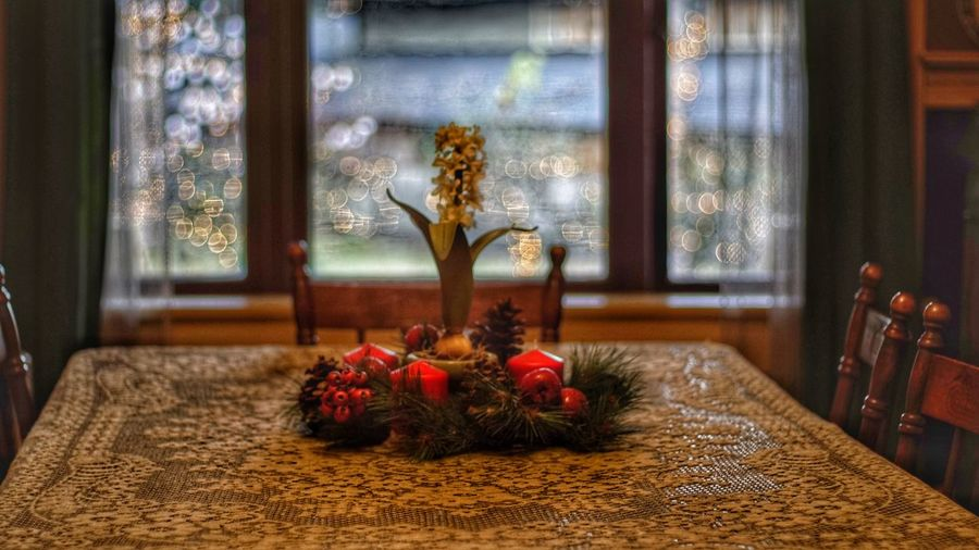 Close-up of christmas decorations on table at home