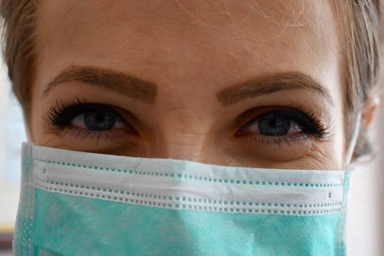 Close-up portrait of doctor wearing protective mask
